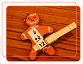 image of a gingerbread man made out of paper, laying on a table